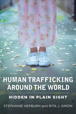 Human Trafficking Around the World: Hidden in Plain Sight (Paperback)