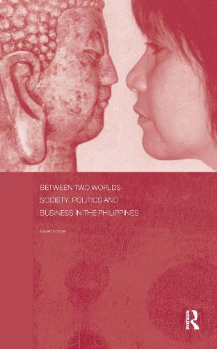 Between Two Worlds - Society, Politics, and Business in the Philippines (Hardback)