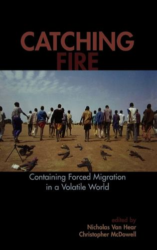 Catching Fire: Containing Forced Migration in a Volatile World - Program in Migration and Refugee Studies (Hardback)