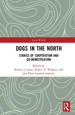 Dogs in the North: Stories of Cooperation and Co-Domestication - Arctic Worlds (Hardback)