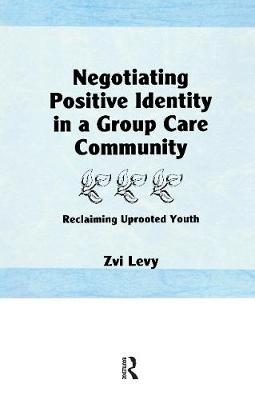 Negotiating Positive Identity in a Group Care Community: Reclaiming Uprooted Youth (Paperback)
