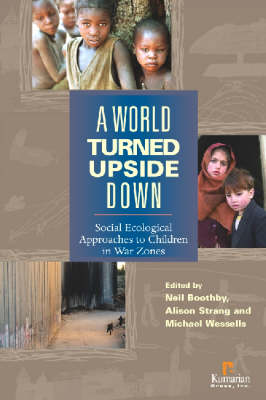 A World Turned Upside Down: Social Ecological Approaches to Children in War Zones (Hardback)