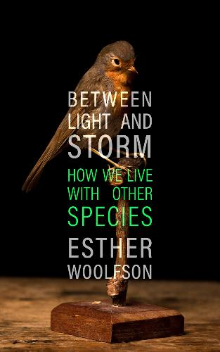 Between Light and Storm: How We Live With Other Species (Hardback)