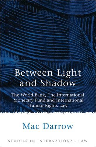 Between Light and Shadow: The World Bank, the International Monetary Fund and International Human Rights Law - Studies in International Law 1 (Paperback)