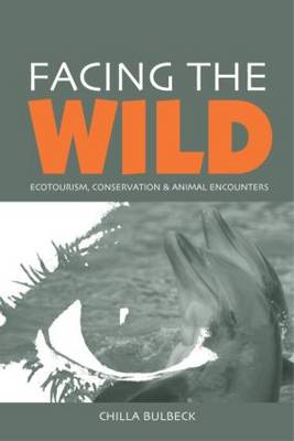 Facing the Wild: Ecotourism, Conservation and Animal Encounters (Paperback)
