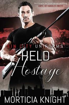 Held Hostage - Sin City Uniforms 4 (Paperback)