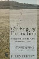 The Edge of Extinction: Travels with Enduring People in Vanishing Lands (Hardback)