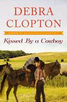 Kissed by a Cowboy - A Four of Hearts Ranch Romance 3 (Paperback)