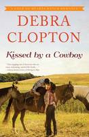 Kissed by a Cowboy - Four of Hearts Ranch Romance 3 (Hardback)
